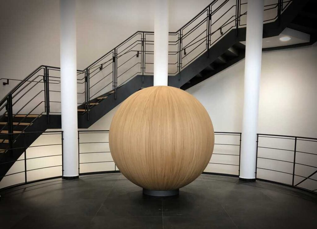 Wood ball art in middle of room